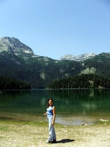 Free Girl On A Rock Near A Glacier Lake At Durmitor Stock Photography - 3411432