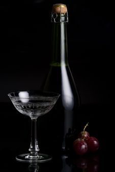 Champagne Bottle, A  Glass And Stock Photo