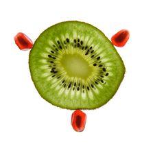 One Kiwi And Pomegranate Stock Photo