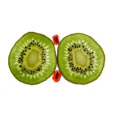 Two Kiwis And Pomegranate Stock Photography