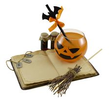 Halloween Drink With Magic Book And Bottles Stock Photography