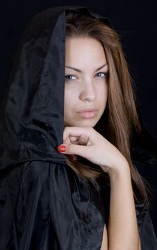 Lady In A Black Cape Royalty Free Stock Photography