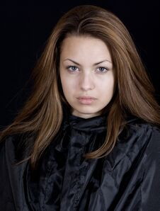 Lady In A Black Cape Stock Images