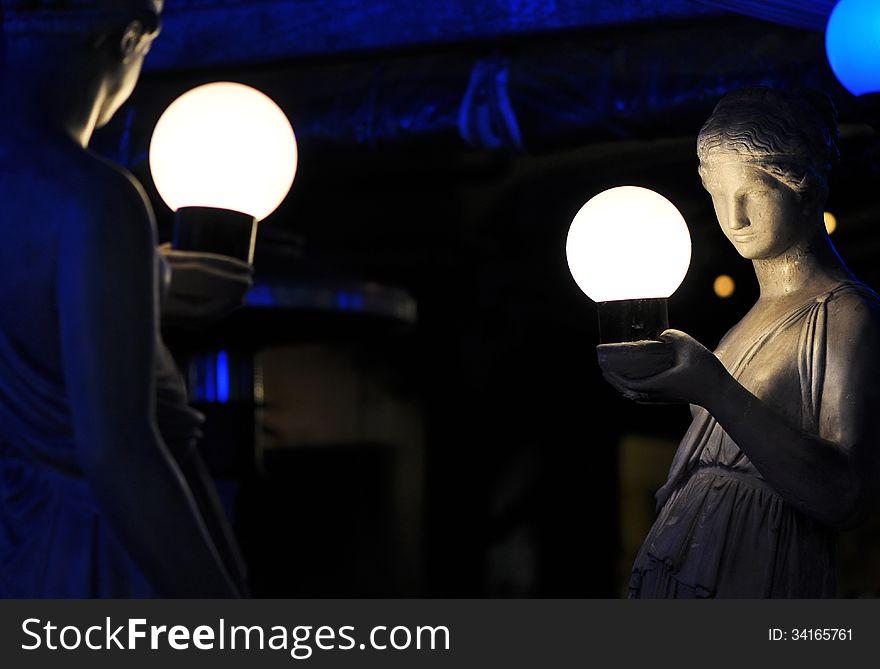 Sculpted statues of Roman women & balls of light