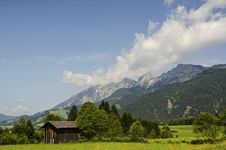 Free An Old Wooden Barn On The Background Of  The Alps Mountains Royalty Free Stock Image - 34181786