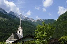 Church With View Of The Alps Mountains In The Background Stock Photos