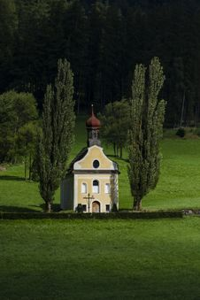 Free Small Church Surrounded With Green Grass And Trees Royalty Free Stock Photo - 34182585