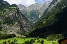 Free Small Village Surrounded With Grass At The Foot Of Alps Mountains Royalty Free Stock Photo - 34182675