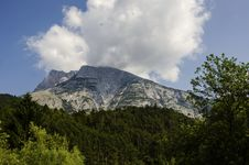Free Alps Mountains With Green Forest Cloud And Blue Sky Royalty Free Stock Photography - 34183527