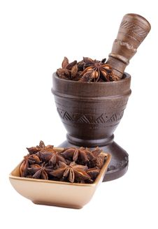 Free Anise Stars In Golden Bowl And Wooden Mortar Stock Image - 34196011
