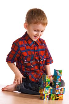 Child Plays About Cubes Royalty Free Stock Photos