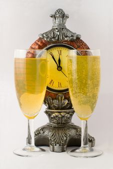 Clock And Two Tall Wine Glass Royalty Free Stock Photos