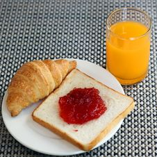 Free Strawberry Jam On Bread, Croissant  And Orange Juice Royalty Free Stock Image - 34203456