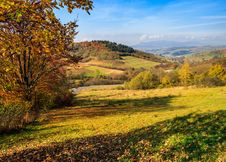 Free Autumn Landscape With Meadow And Village  In Mountains Stock Image - 34257911