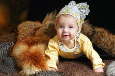 Baby, Fox Pelt And Hauberk Royalty Free Stock Image