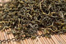 Dried Green Tea On The Background Royalty Free Stock Photos