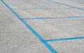 Free Empty Parking Spaces With Blue Stripes Stock Photo - 34282960