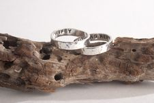 Free Hammered Rings On Driftwood Stock Photography - 34283552