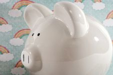 Free Piggy Bank Against Rainbow Background Stock Images - 34284044