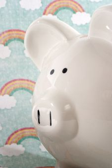 Free Piggy Bank Against Rainbow Background Stock Images - 34284094