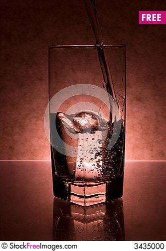 Free Liquid Being Poured Into Glass Stock Photo - 3435000