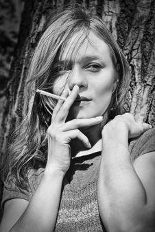 Blond Smoking Girl Royalty Free Stock Photo