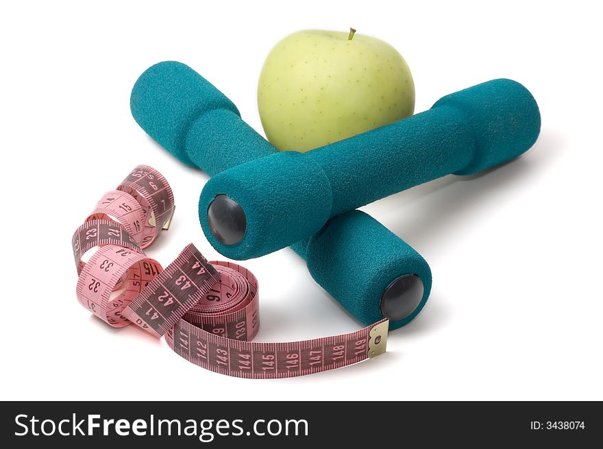 Dumbells, apple and measuring