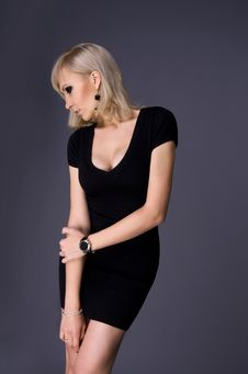 Free Blond Woman In A Slinky Dress Stock Image - 34308951