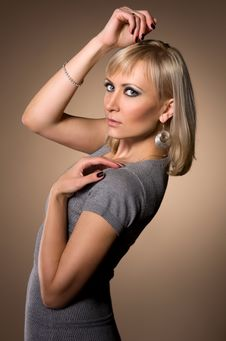 Free Blond Woman In A Slinky Dress Royalty Free Stock Images - 34309639
