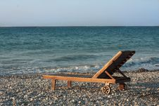 Wooden Chair On The Beach Stock Photos