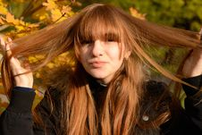 Young Red-haired Girl Stock Images