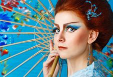 Free Geisha In A Smart Dress With Umbrella Royalty Free Stock Photo - 34383405