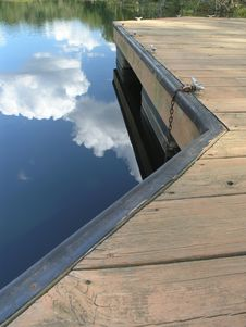 Reflective Clouds And Dock 2 Stock Photos