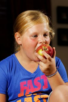 Free Girl Eating Apple Stock Images - 34455714