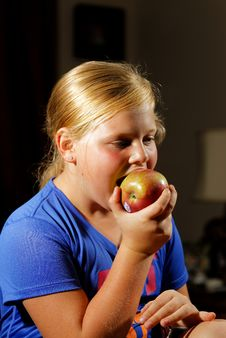 Free Girl Eating Apple Royalty Free Stock Photo - 34455715