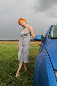 Woman In Dress With Blue Car Royalty Free Stock Image