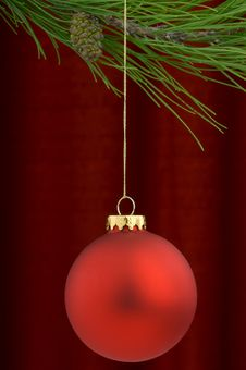 Free Red Christmas Ornament On A Burgundy Background Stock Photography - 3458802
