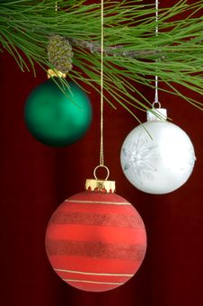 Free Multicolored Ornaments On Burgundy Background Royalty Free Stock Photography - 3458957
