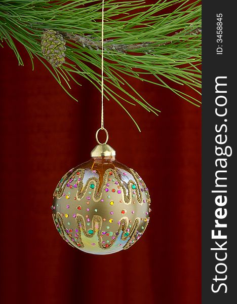Gold Christmas Ornaments On Burgundy Background Free Stock Images