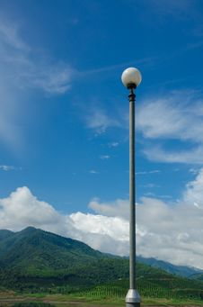 Free Blue Sky And Mountain Background With Lamp Pole Royalty Free Stock Photos - 34512998