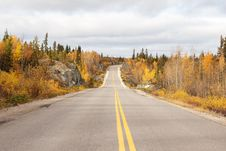 Free A Highway Through A Fall Forest Royalty Free Stock Images - 34580829