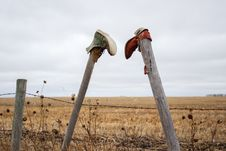 Free Two Boots Hanging On Fence Posts Stock Photography - 34588172