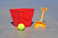 Free Red Bucket Spade And Ball On The Beach Royalty Free Stock Photo - 34592065