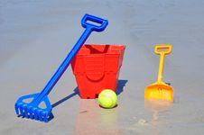 Free Red Bucket Spade Ball And Rake On The Beach In A G Royalty Free Stock Photography - 34592157