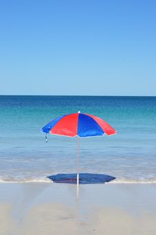 Free Umbrella By The Sea Stock Photos - 34593313