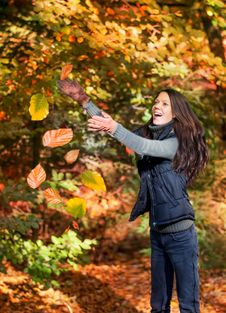 Free Woman Catching Leaves Royalty Free Stock Photography - 34595877