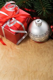 Free Xmas Gift Box And Ornaments On Old Paper Backgroun Stock Photos - 34599913