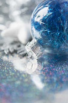 Free Blue And Silver Xmas Ornaments On Bright Holiday B Stock Photos - 34599983