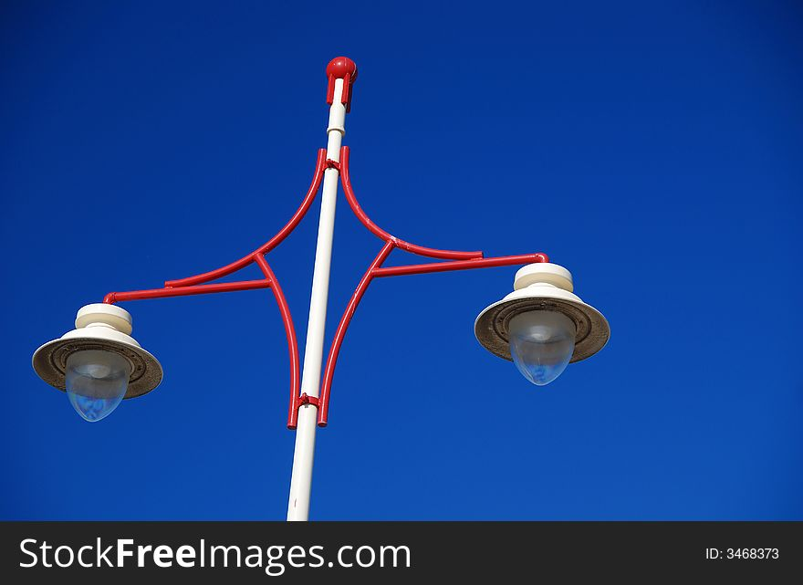 Red white and blue lamppost