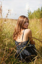 Free Girl Sitting In Cornfield Royalty Free Stock Images - 34600239